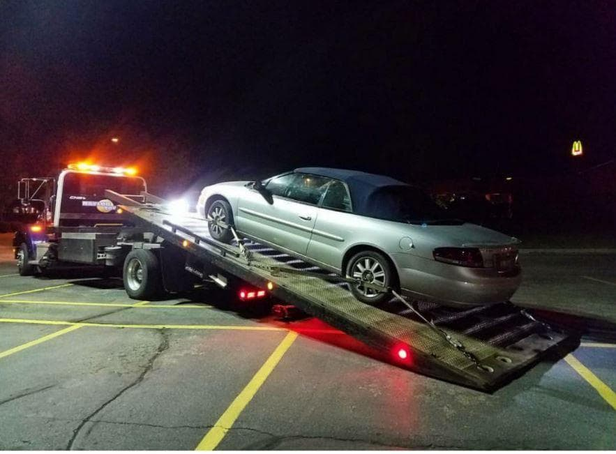 Vehicle on flatbed tow truck